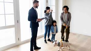 Asian Family Looking at House